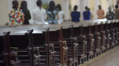 View from behind of people sitting in church Stock Footage