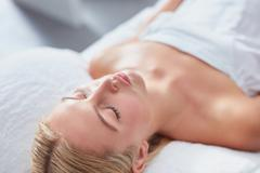 Attractive woman at dayspa for skin treatment - stock photo