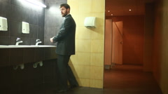 Man in a public restroom Stock Footage