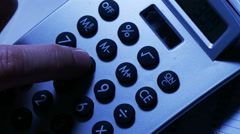 Man using calculator, overhead rotation - stock footage