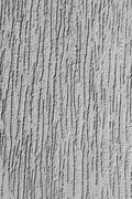 Relief plaster grey wall - stock photo