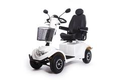 Generic electric mobility scooter for disabled or elderly people against whit Stock Photos