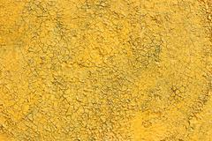 Shelled and cracked old painted yellow surface Stock Photos