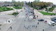 Aerial view of marathon city runners Stock Footage