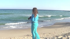 Woman recording sea Stock Footage
