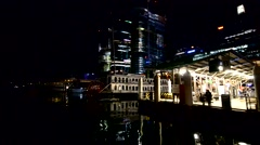 Arriving in Sydney Darling Harbour at night from the sea - stock footage