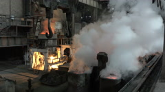 The vapor above the workpiece after the spill metal and extinguish it with water Stock Footage