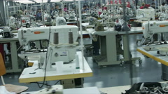 Modern Textile factory with workers sewing in great working conditions. Stock Footage