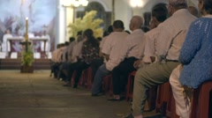 People sit at night easter service in Catholic church Stock Footage