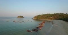 Aerial hover of longboats at kata beach Stock Footage