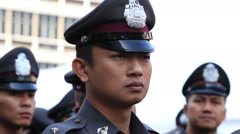 Thai policeman to keep order in Chinatown during Chinese New Year in Bangkok - stock footage