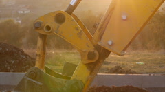 Digger machine digging hole. Excavation of canal. - stock footage