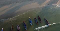 Aerial flyaway longboats at kata beach Stock Footage