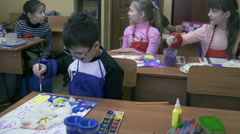 Small children on creative lesson in primary class - stock footage