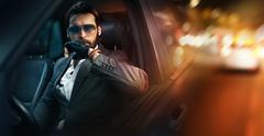 Outdoor portrait of fashion man driving a car - stock photo