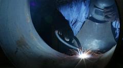 Welder inside a big  Pipe. - stock footage