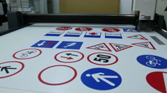 Wide Format Computer controlled cutter, cutting street signs Stock Footage