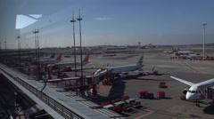4k Airport Hamburg panning shot airplanes at gates Stock Footage
