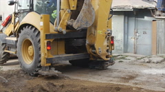 Digger machine digging hole. Excavation of canal. Stock Footage