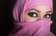 close-up beautiful mysterious eyes eastern woman wearing a hijab - stock photo