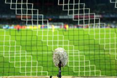 Professional sport microphone on a soccer field behind the net - stock photo