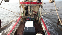 A shrimp boat at the North Sea during a workday. Stock Footage