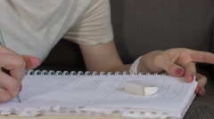 Stock Video Footage of Web designer mocks up website in sketchbook
