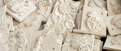 Box of ceramic tiles ready to be glazed. Stock Photos