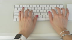 stylish woman types on keyboard and uses mutlitouch trackpad on computer - stock footage