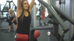 Beautiful young woman doing exercises to strengthen the shoulder simulator - stock footage