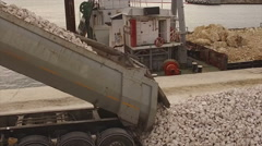 Cargo tow leaving rocks on port Stock Footage