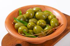Bowl of fresh green olives - stock photo