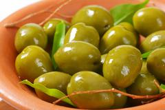 Bowl of fresh green olives Stock Photos