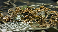 Closeup rotation of a treasure with coins, jewels and chains. Stock Footage