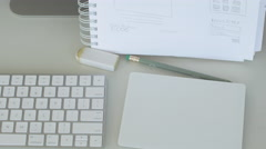 Keyboard and sketch pad close up -slider shot Stock Footage