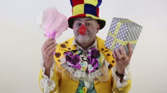Clown gives flowers and a gift Stock Footage