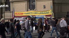 Tourists pass by an Ukraine support spot in Prague. Documentary - stock footage
