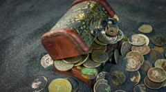 Old casket and old coins on a sand background close up rotation. Stock Footage
