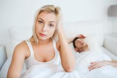 awake woman having insomnia in bed - stock photo