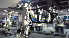 Assembly line production robot on display at trade show Shanghai, China Stock Footage