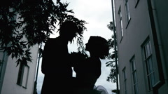 Young Couple in a silhouette dark Stock Footage