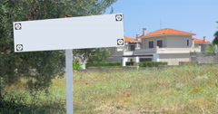 Blank advertising sign in front of the houses Stock Footage