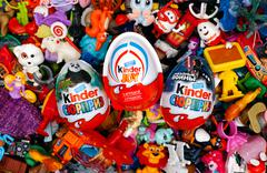 Big heap of Kinder Surprise toys and eggs. Stock Photos