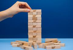Player hand build Jenga tower constructed Stock Photos