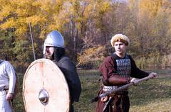 Warriors in old Russian armors reconstructed medieval fight - stock photo