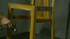 Wooden chair dye house painting Stock Footage