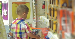 Boy Choosing Toys in the Shop Stock Footage