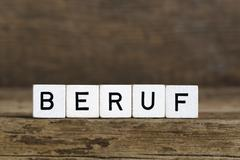 The German word profession written in cubes - stock photo