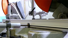 Cutting PVC profile with circular saw, plastic windows manufacture Stock Footage