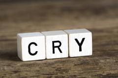 The word cry written in cubes Stock Photos